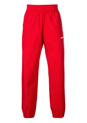 Heron Preston logo print track pants - Red