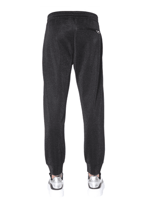 JOGGING PANTS WITH SKULL PATCHES