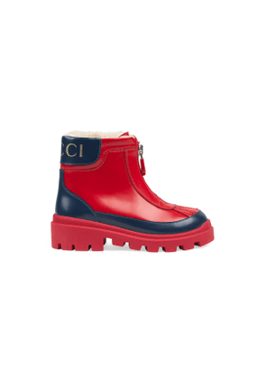 Toddler leather boot with faux fur lining