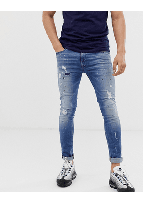 Jack & Jones Intelligence skinny fit jeans with paint spray detail in blue