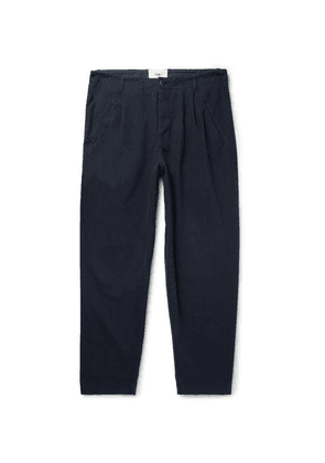 Folk - Navy Assembly Tapered Pleated Cotton-canvas Trousers - Navy