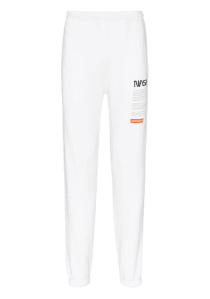 Heron Preston NASA text print sweatpants - White