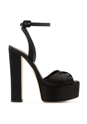 Giuseppe Zanotti - these sandals are set on a chunky heel. They are made with a generous plateau and detailed with a crossover front strap. BETTY