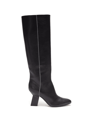Angular heel thigh high leather boots