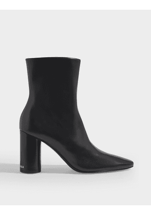 Oval 90 Ankle Boots in Shiny Black Leather