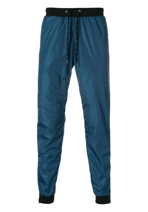 Andrea Crews side stripe track pants - Blue