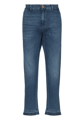 Gucci logo-embroidered tapered jeans - Blue