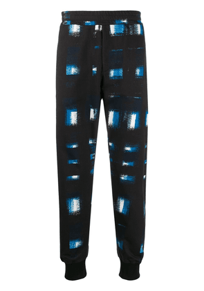 Alexander McQueen printed tapered track trousers - Blue