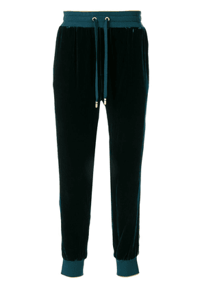 Dolce & Gabbana embroidered crest track pants - Green