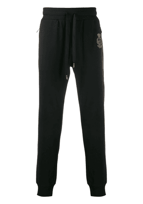 Dolce & Gabbana heraldic embroidered motif track pants - Black