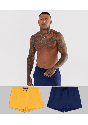 ASOS DESIGN swim shorts in navy and mustard super short length 2 pack multipack saving