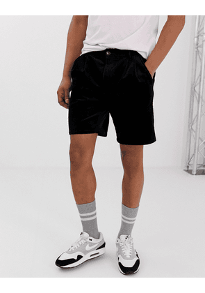 ASOS DESIGN slim shorts with pleats in black cord