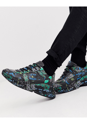 ASOS DESIGN trainers in black with graffiti print and chunky sole