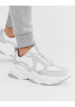ASOS DESIGN trainers in white and grey with chunky sole