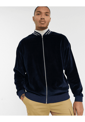 ASOS DESIGN oversized bomber jacket in velour with silver stripe tipping-Navy