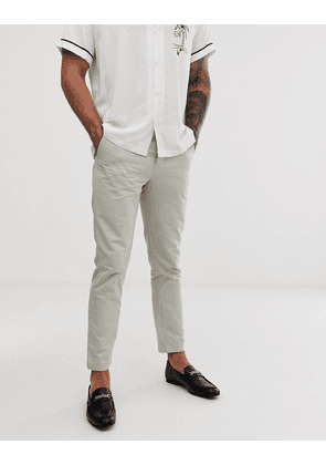 ASOS DESIGN slim trousers in stone peached cotton