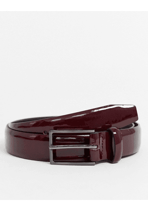 ASOS DESIGN faux leather patent belt in burgundy-Red