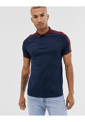 ASOS DESIGN organic polo shirt with contrast shoulder panel in navy