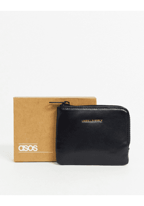 ASOS DESIGN faux leather zip around wallet in black with foil emboss