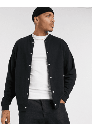 ASOS DESIGN oversized jersey bomber jacket with poppers in black