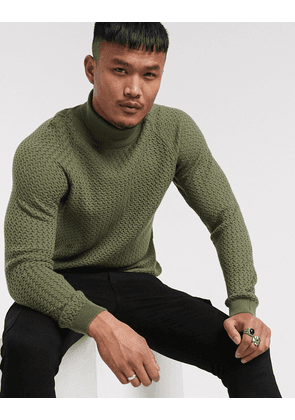 ASOS DESIGN knitted roll neck jumper with basket texture in khaki-Green