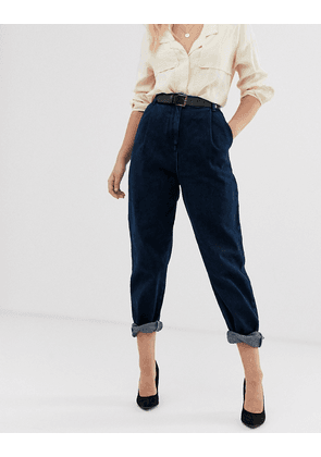 ASOS DESIGN tapered boyfriend jeans with curved seams and belt in indigo wash-Blue