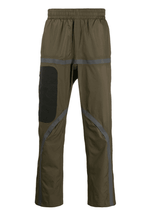 Oakley By Samuel Ross contrast stripe-detail trousers - Green