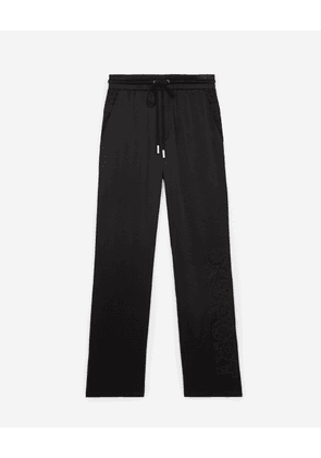 The Kooples - Flowing black trousers with lace detailing - WOMEN