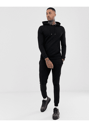 ASOS DESIGN muscle tracksuit with hoodie & super skinny joggers in black
