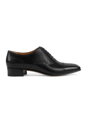 Leather lace-up with brogue detail