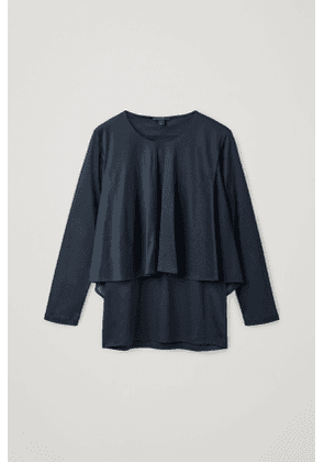 TOP WITH DRAPED LAYERS