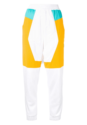 Reebok panelled track style trousers - White