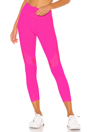 ALALA Crop Vamp Tight in Pink. Size L.