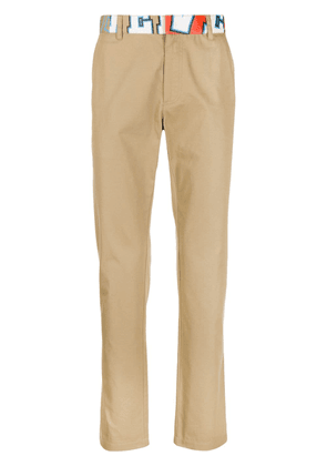 Versace abstract logo print slim trousers - NEUTRALS