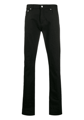Alexander McQueen dragon patch tapered jeans - Black