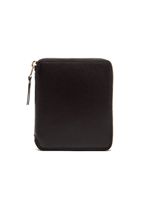 Comme Des Garcons Zip Fold Wallet in Black - Black. Size all.