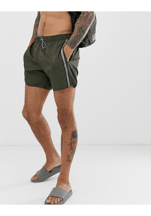 Emporio Armani taped logo swim shorts in khaki-Green