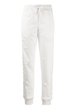 Dolce & Gabbana star embossed track pants - White