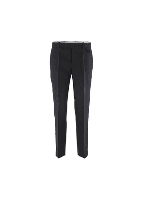 Compact trousers in wool.