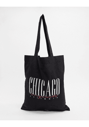 ASOS DESIGN organic cotton tote bag in black with 'chicago' print