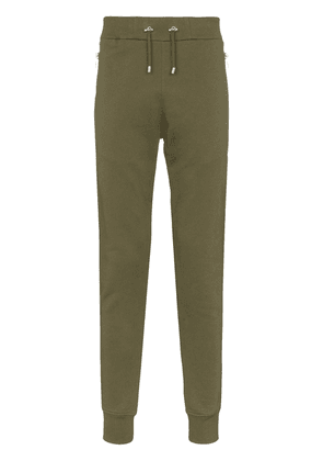 Balmain embossed logo sweatpants - Green