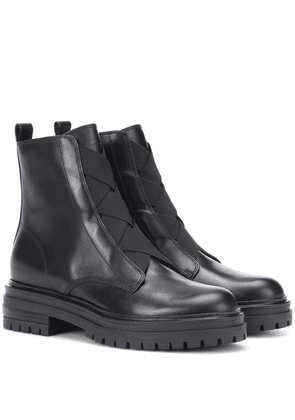 Elasticized leather ankle boots