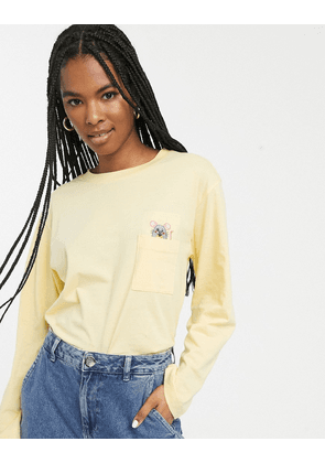 Monki organic cotton mouse pocket long sleeve tee in yellow