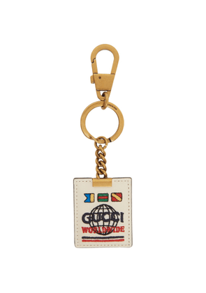 Gucci Off-White and Gold Gucci Worldwide Keychain