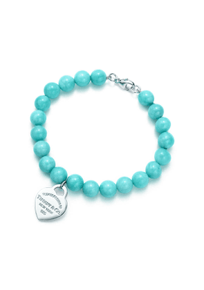 Return to Tiffany™ small heart tag in silver on an amazonite bead bracelet