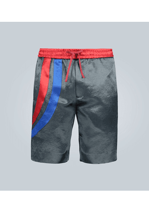 Mid-length shorts with bands