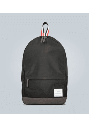 Suede-trimmed canvas backpack