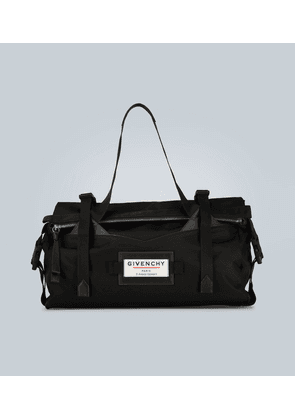 Downtown leather-trimmed holdall