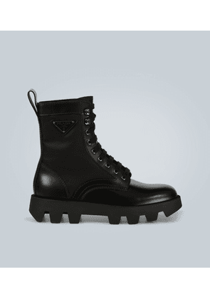 Chunky-sole leather-trimmed boots