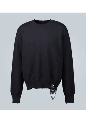 Distressed cotton knitted sweater
